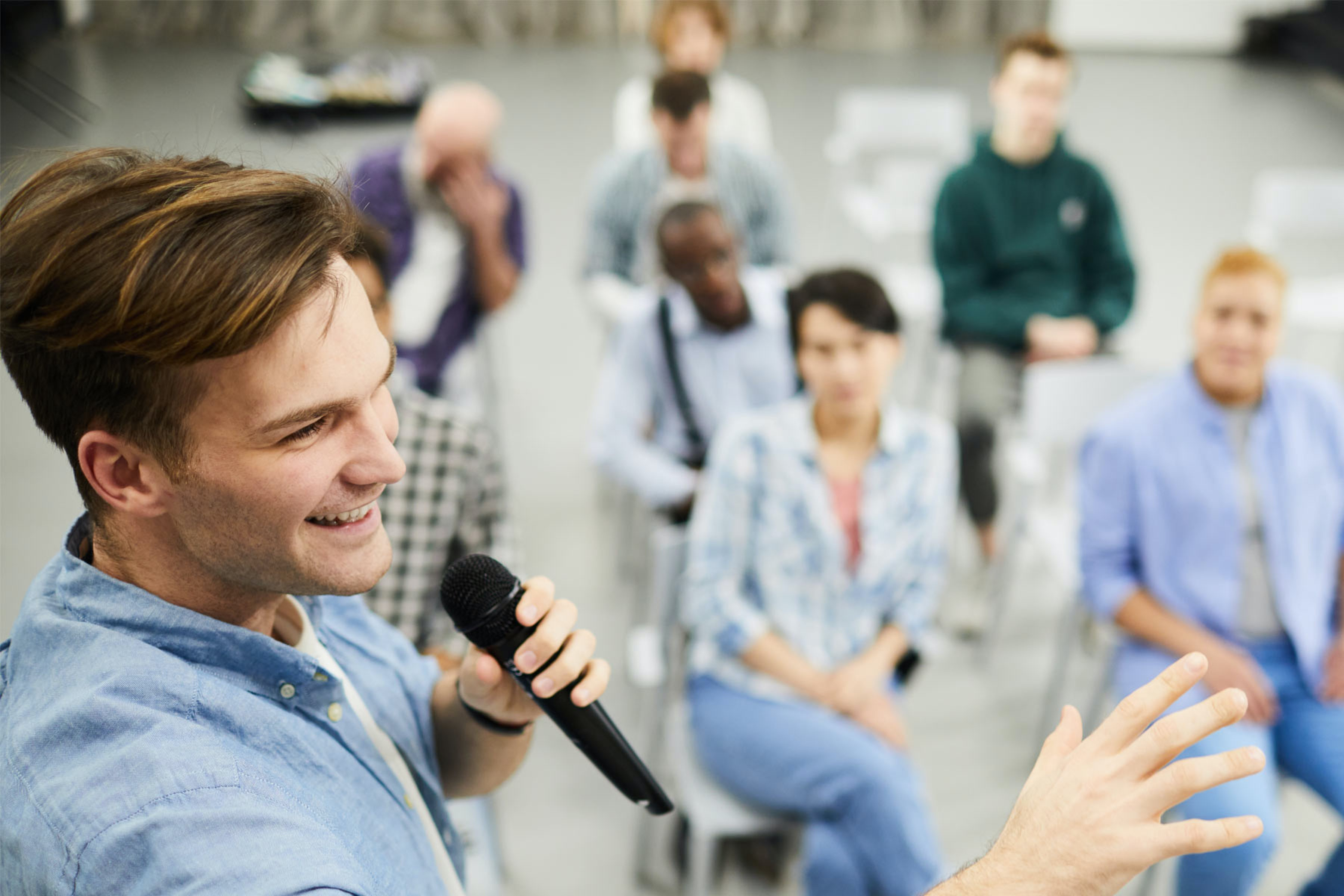 a man with a microphone leads a presentation