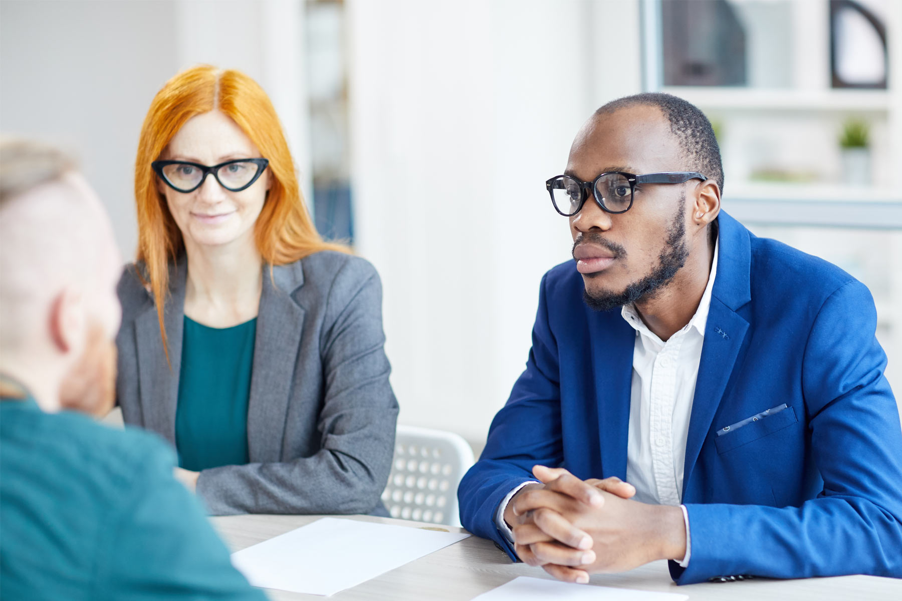 two consultants talking with client in office