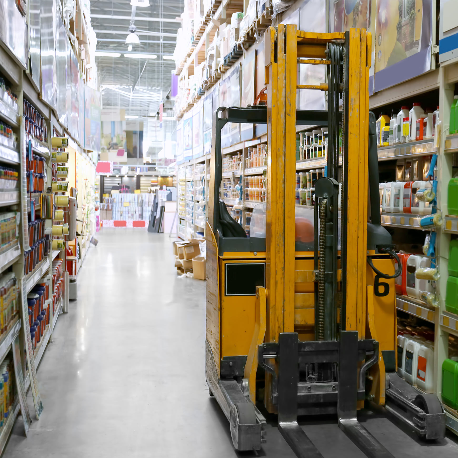 forklift in an aisle in a shop or warehouse