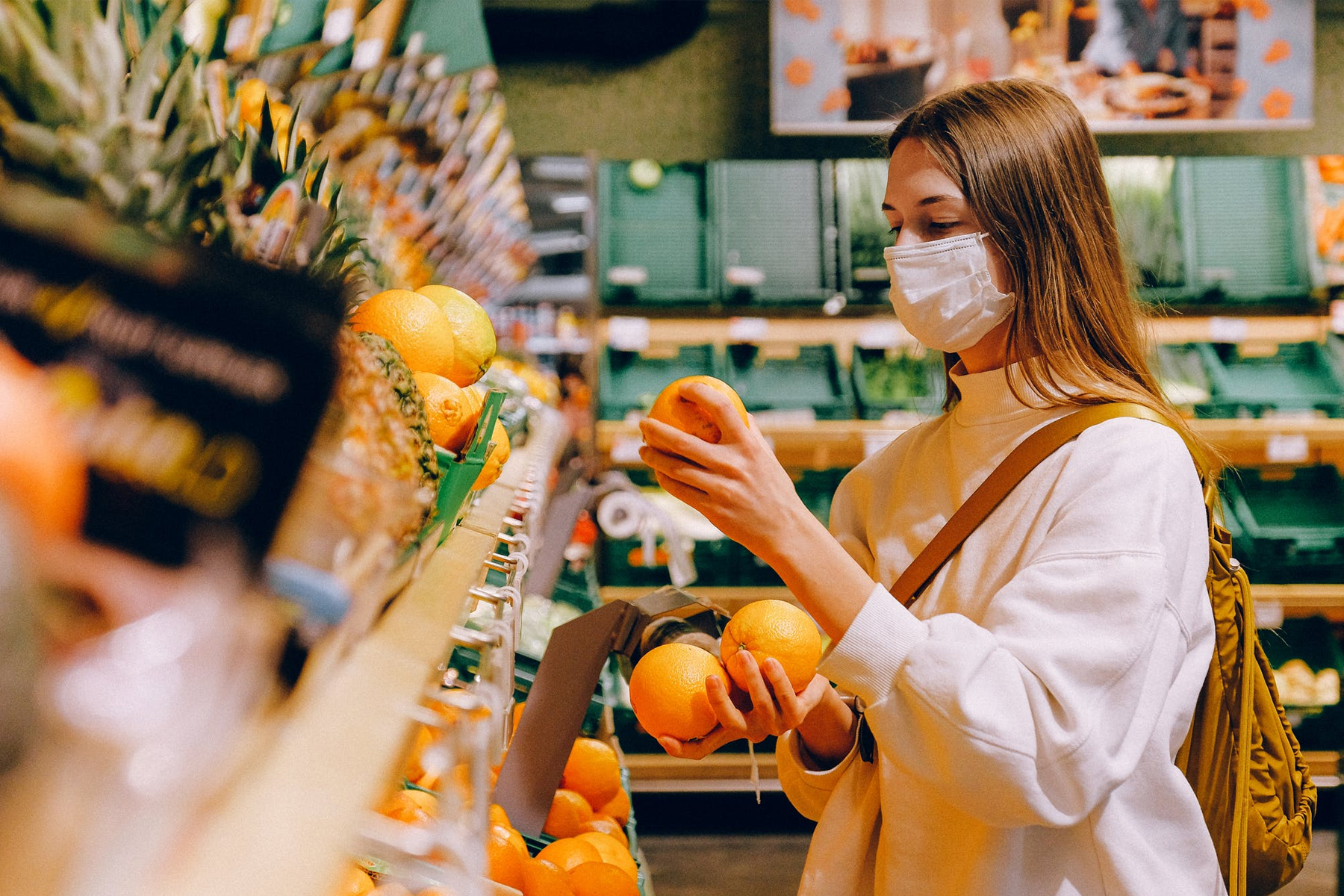 customer in a grocery store with a face mask on
