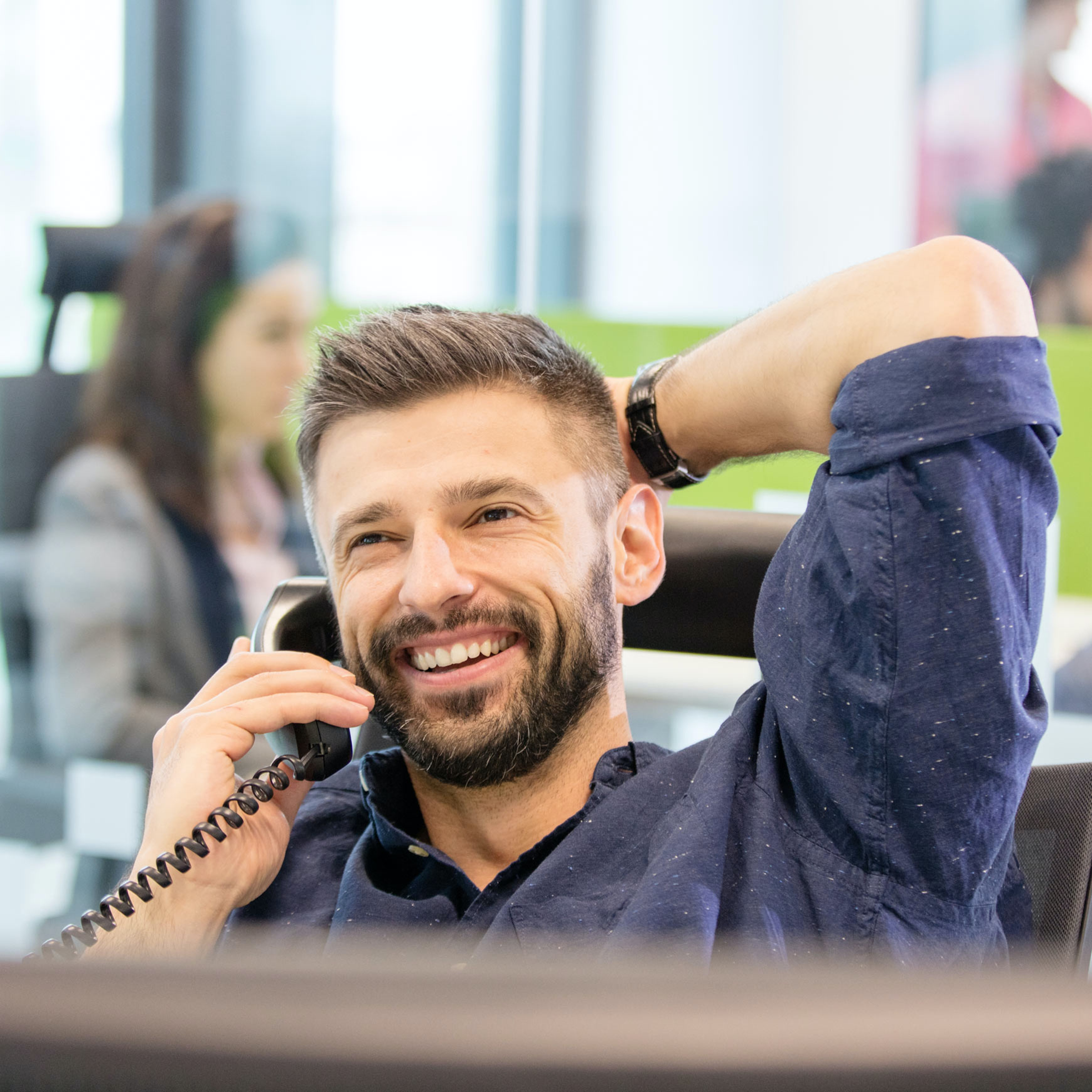 a happy employee is on the phone in an office