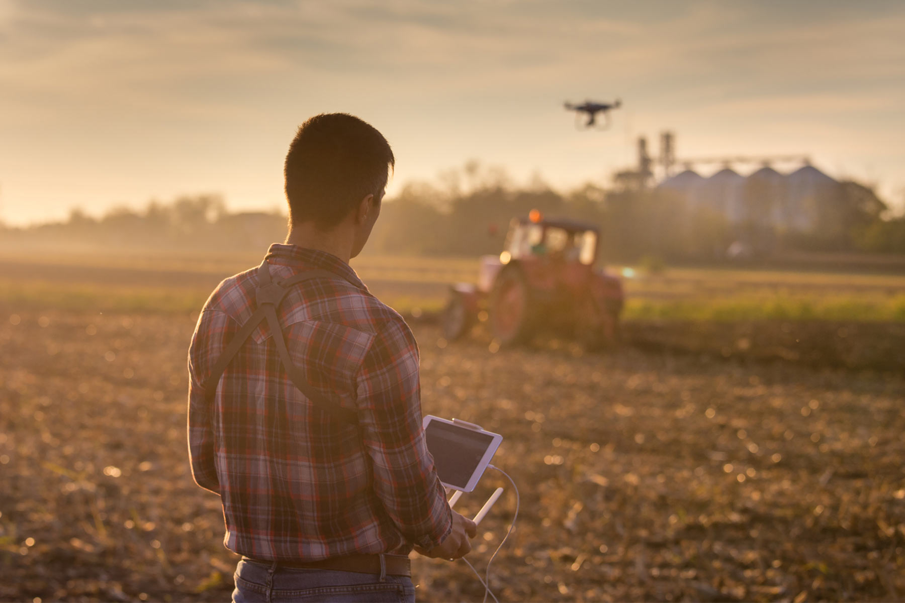 farmer using tablet and drone in a field