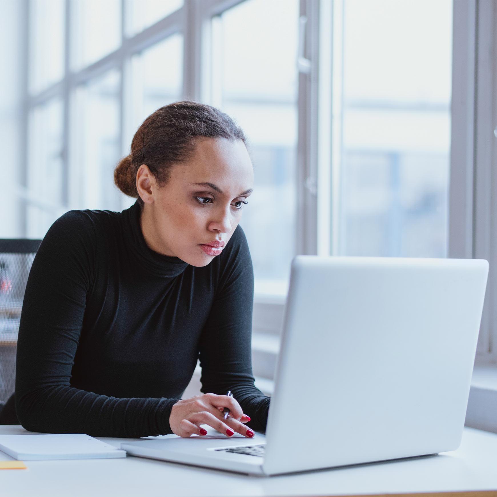 female employee using laptop in an office
