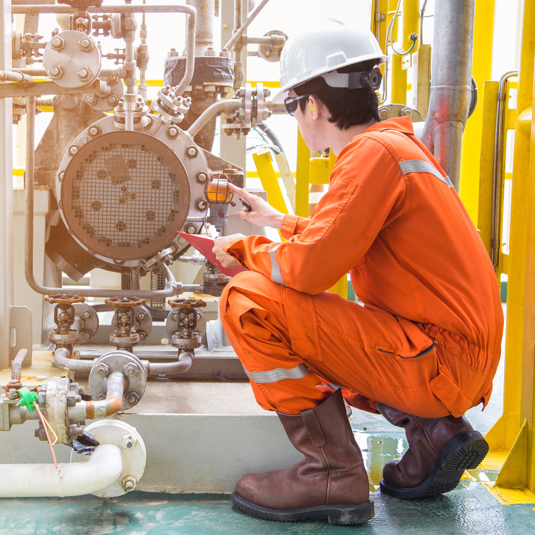 field worker inspecting chemical plant machinery