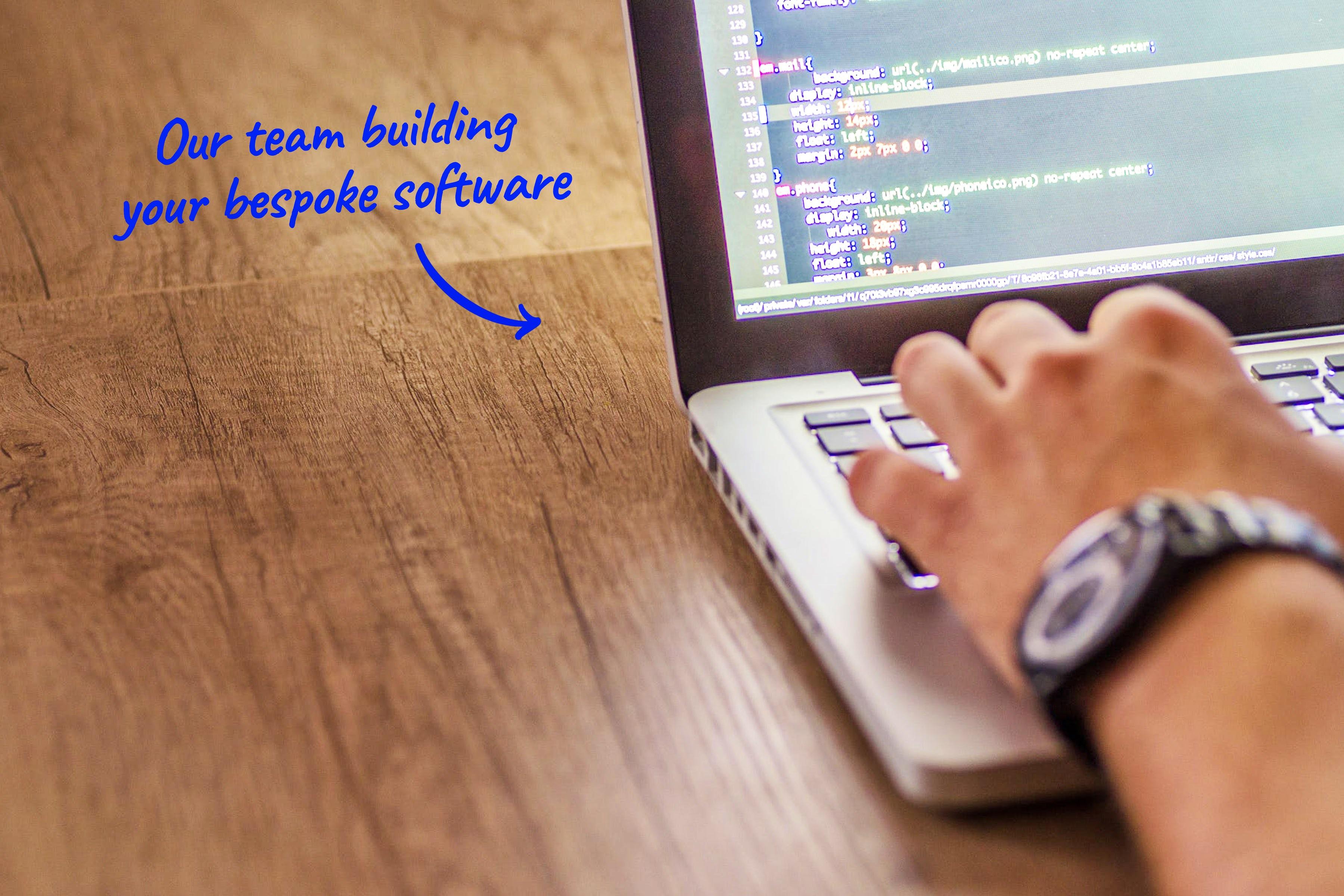 developer programming on a laptop