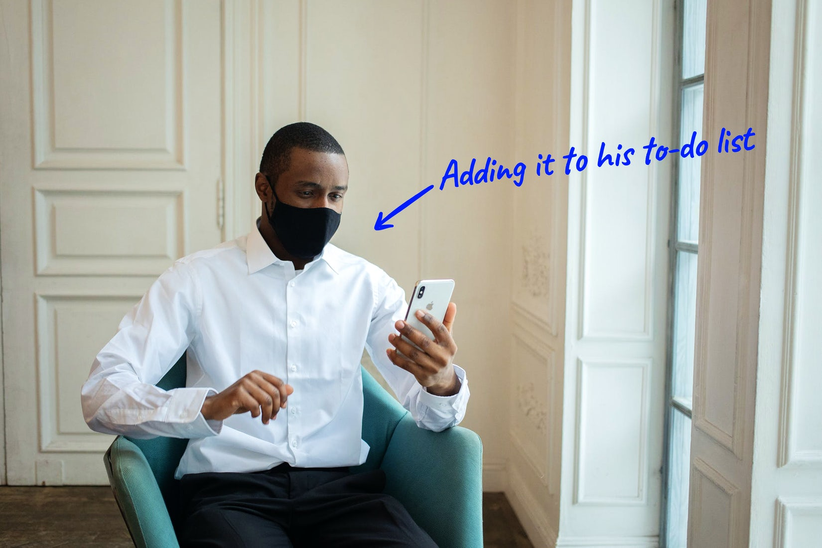 man looking at a smartphone
