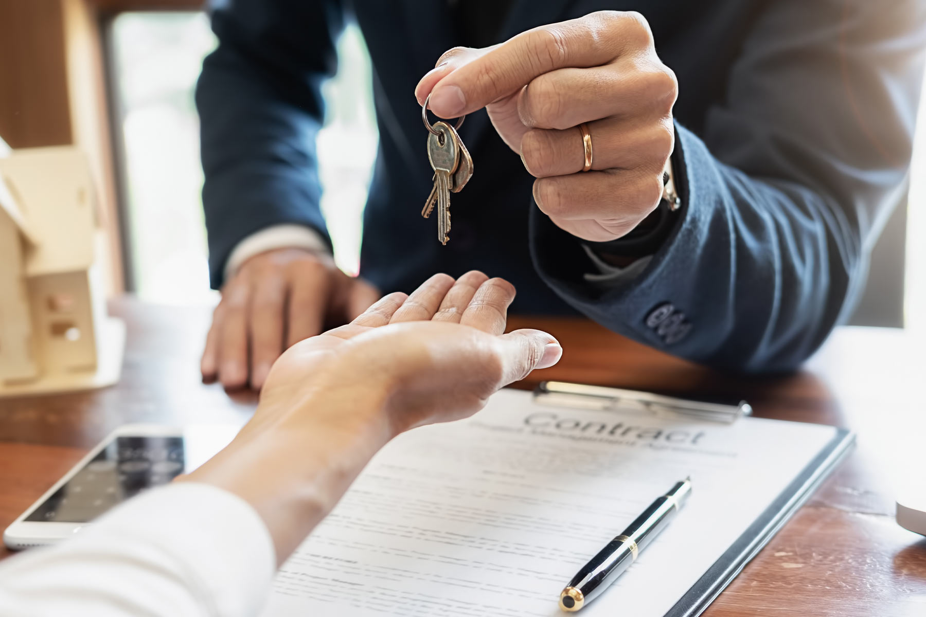 estate agent handing over keys during meeting