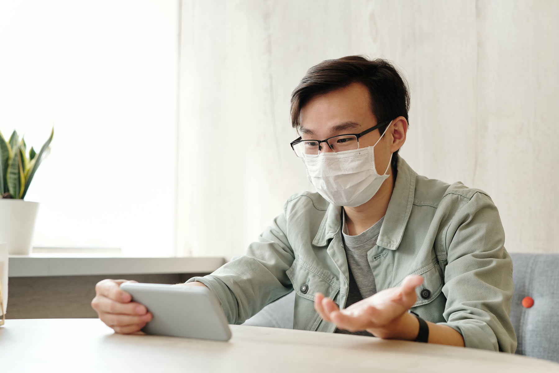 someone wearing a mask on a video call on a smartphone